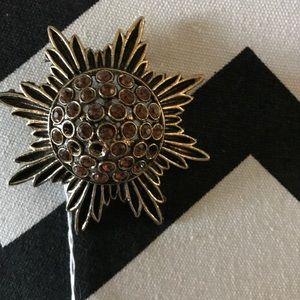 Vintage sunburst brooch.